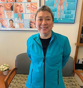 Suan, the head dental assistant at K.I.S.S. Dental Care